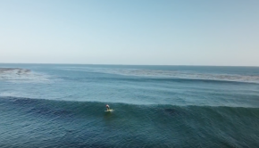 Laird Hamilton paddling into a 1 minute ride on his Hydrofoil SUP in Malibu