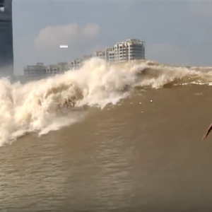 """Surfing China's River Wave - The """"Silver Dragon"""""""