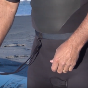Using the Paddle Belt to paddle hands-free through breaking surf