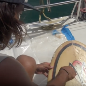How to fix your own surfboard dings and save money - from a boat!