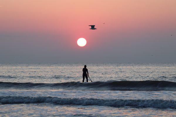 Sarah de Jaegher paddling at sunset off the Belgian coast.