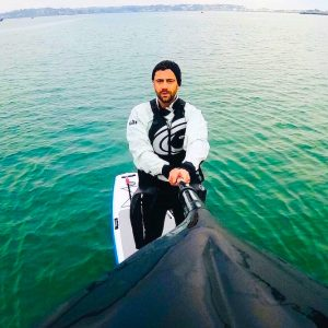 david haze paddle boarding on a lake