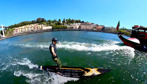 Watch SUP boarder Bruno Hasulyo surfing the wake of a boat down a river in Portugal, there isn't really the need for a paddle in this case, amazing!